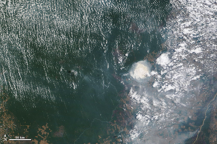 Satellite image of cloud and smoke interactions in the Brazilian Amazon.