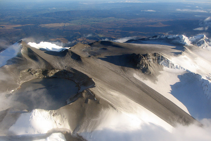 Photograph of dark ash on the summit of Mount Ruapehu.