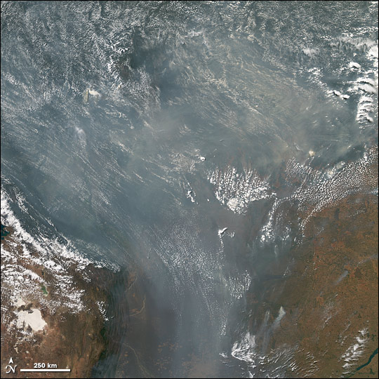 Satellite view of fires and smoke covering the southern Amazon.