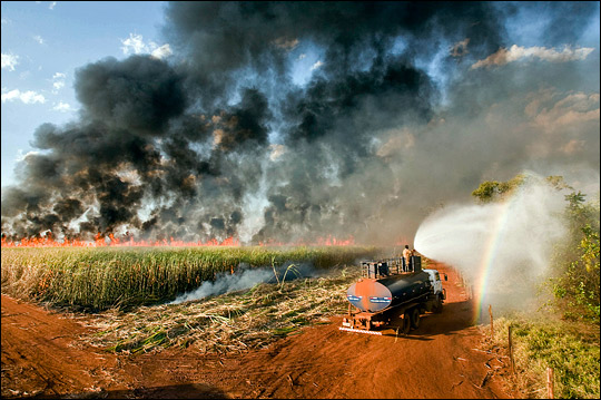 Photograph of burning fields of sugar cane in southern Brazil.