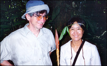 Photograph of Rong Fu and a colleague in the Amazon forest.