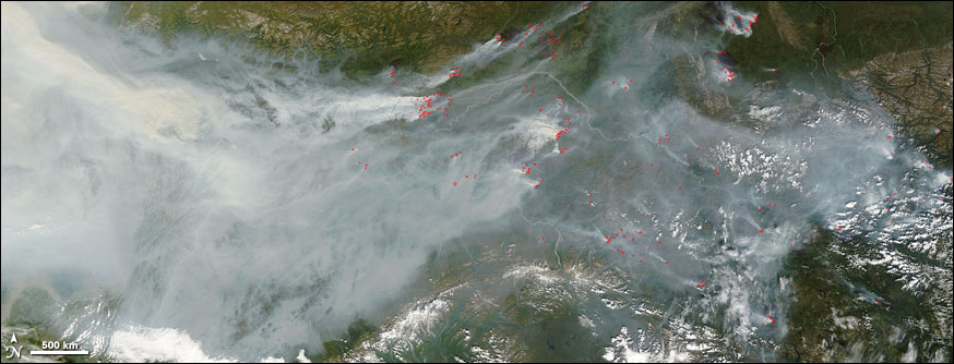 Satellite image of smoke and fires in Alaska during the summer of 2004