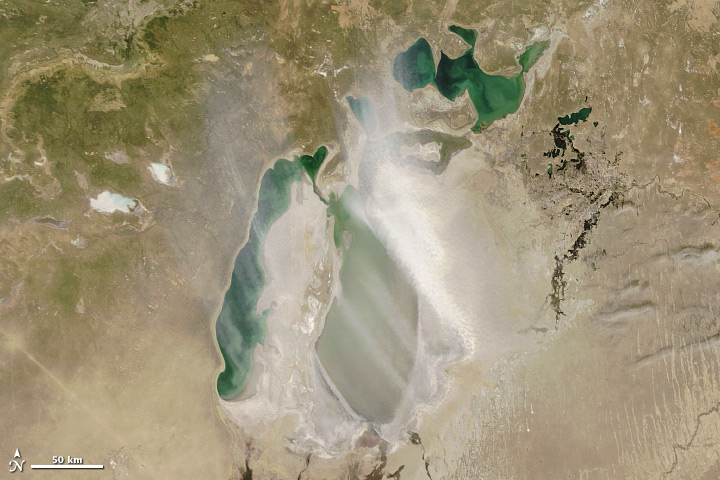 Satellite image of dust blowing from recentl-exposed seabed along the edge of the retreating Aral Sea.