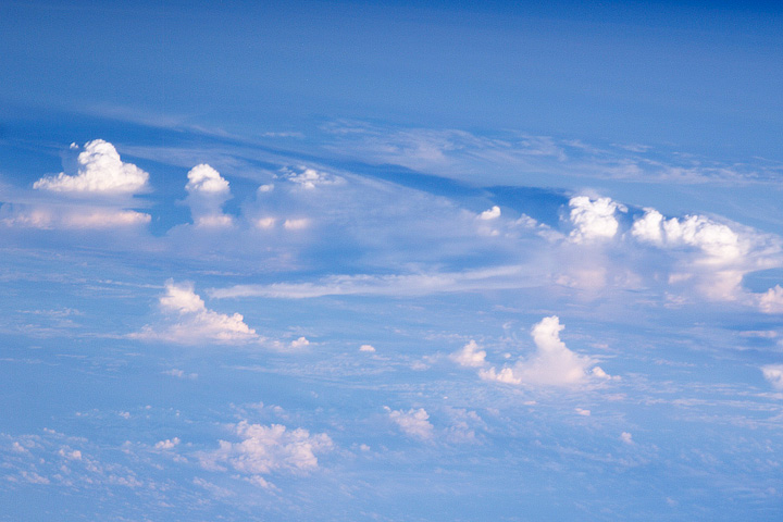 Astronaut photograph of cumulus towers from the ISS.