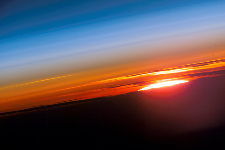 The setting sun, photographed from the International Space Station.