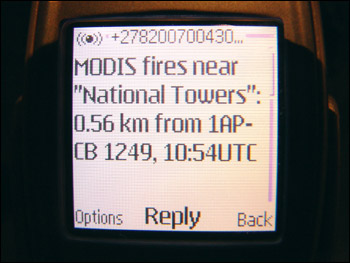 Photograph of fire alert on a cell phone.