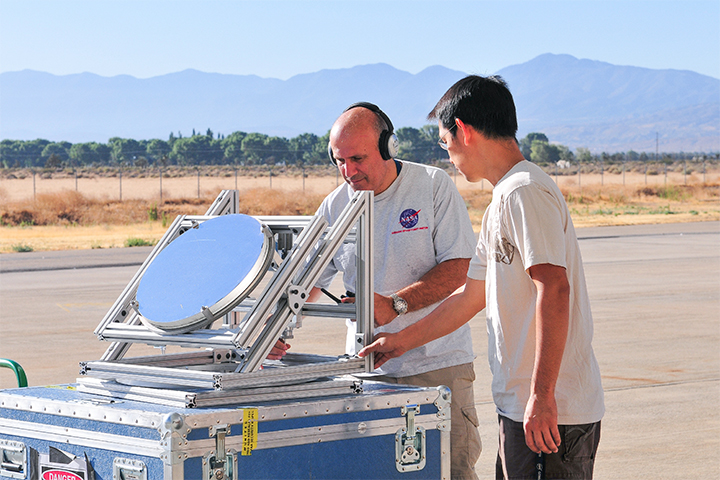 Principal investigator Haris Riris and Stewart Wu demonstrate a prototype methane sounder.