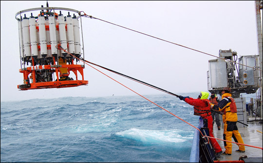 Photograph of the recovery of a sampling rosette aboard the R/V Roger Revelle in the Southern Ocean, February 2008.