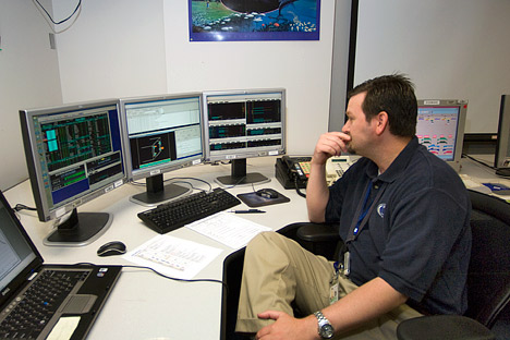 Photograph of James Palowski in the Aqua control room, NASA GSFC.