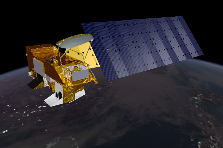 Rendering of the Aqua satellite as it orbits over the nighttime North Pacific.