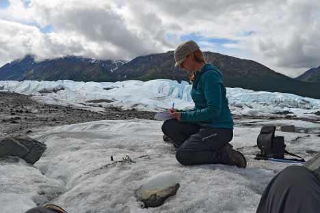 Kimberley Casey working with a themrochron (a small, automated thermometer) on the Matanuska Glacier, Alaska.