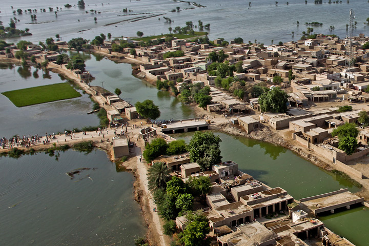 Photograph of flooded fields surrounding a Pakistani village near the Pano Aquil air base.