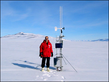 Photograph of Jim Key Standing beside an Isolated Polar Weather Station
