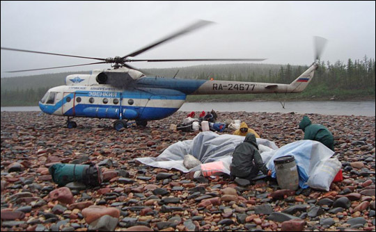 Photograph of helicopter and gear, Kotuykan River, Siberia.