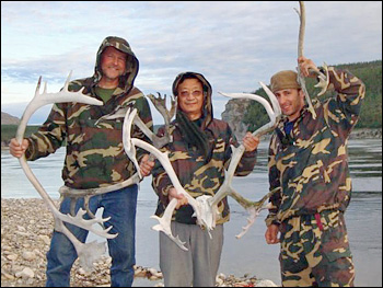 Photograph of Ross Nelson, Guoqing Sun, and Paul Montesano holding reindeer antlers.
