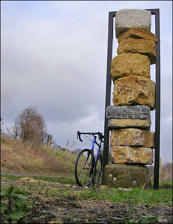 Photograph of Jerry Ortmans' Stone Column, at the start of Colliers Way.