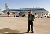 Photograph of Paul Newman standing in front of NASA's DC-8 research aircraft.