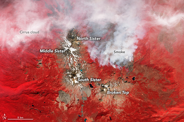 A false-color image of the Three Sisters Wilderness area and smoke from a nearby wildfire.