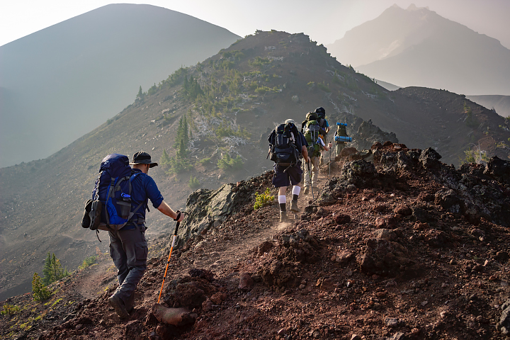 A group of hikers make their way through Three Sisters Wilderness, Oregon.