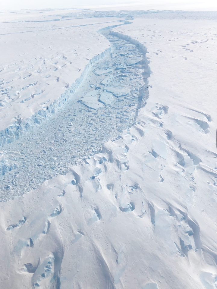 This photo, shot by NASA science writer Kate Ramsayer during a research flight on November 7, 2018, shows sea ice between Pine Island Glacier and the newly calved Iceberg B-46.