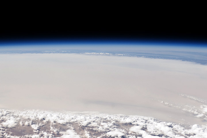 Astronaut photograph of dust over the Taklamakan Desert.