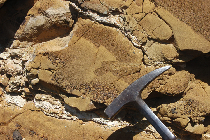 Photograph of Table Rock Tuff, Oregon, with hammer for scale.