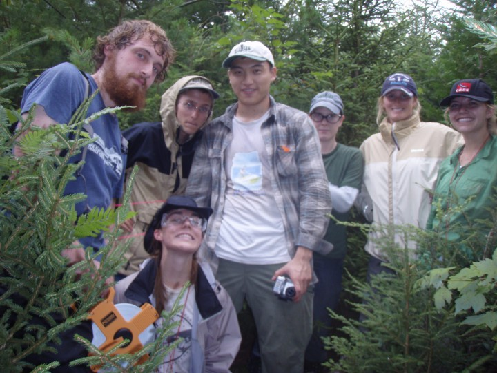 The Howland team demonstrating safety in science by wearing eye protection in dense forest.  From left: Chad Babcock, Will Broussard, Qiang Fu, Lisa Calhoon, Kelly Easterday.  In front: Corie Lahr.