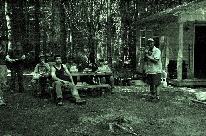 This photo of the Howland team at their cabin could almost be mistaken for mid 1800s logging camp, so little has changed. From left: Corie Lahr, Lisa Calhoun, Will Broussard, Qiang Fu, Chelsea Robinson, Kelly Easterday and John Lee. Photo by Sassan Saatchi.