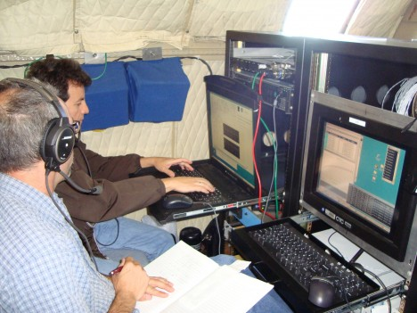 Rafael Rincon and Martin Perrine hard at work testing the DBSAR RAID, which had an intermittent problem collecting data rapidly, but only in flight. The repair efforts were successful.