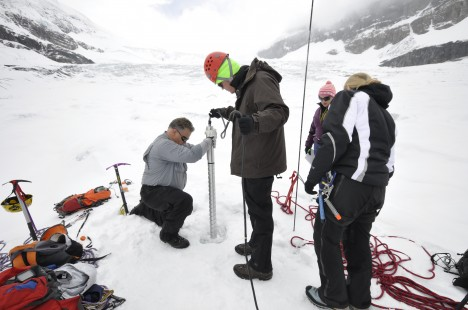 Randy Skinner, Jessica Williams, and BYU students drilling an ice core on Athabasca Glacier.