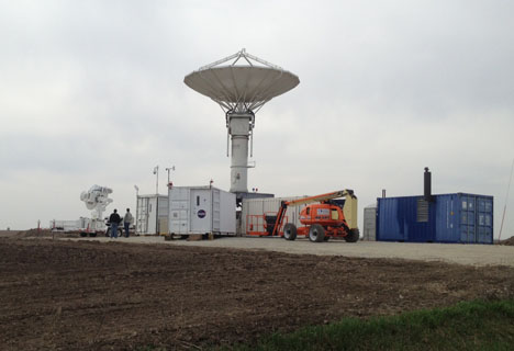 The NPOL radar standing tallin an Iowa field.
