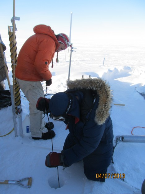 Lowering the second thermistor string down the 30-meter hole.