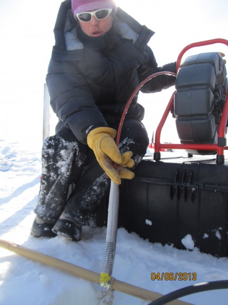Lora holding the video camera that she will send down in the hole to monitor the snow and ice layering.