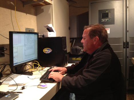 Dave Wolff is a radar scientist at NASA Wallops. He monitoring the radar data inside the science trailer on site at Traer, Iowa. Credit: Walt Petersen / NASA