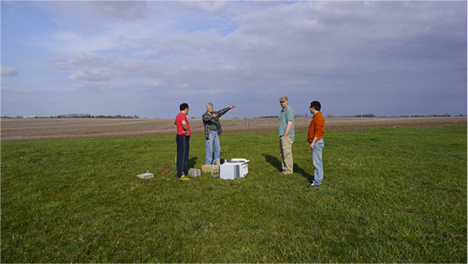 Gilles Molinié, Université Joseph Fourier and Witold Krajewski, Jim Neimeier, and Bo Chen, Iowa Flood Center, discuss the location for a disdrometer for the IFloodS campaign. Molinié brought the disdrometer from Switzerland to collect data during the IFloodS campaign. Credit: Fred Ogden, University of Wyoming.