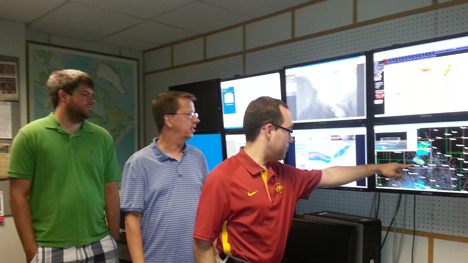 Iowa State University Forecasters Dr. William Gallus (middle) and Graduate Assistants Brian Squitieri (right) and Ben Moser (left) evaluating storms in real time and determining the areas that might be at greatest risk for experiencing flooding conditions and severe weather.