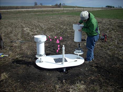 April 15, 2013. Kara Prior installs a rain gauge and soil moisture platform in the Turkey River basin in northeast Iowa. Credit: Iowa Flood Center