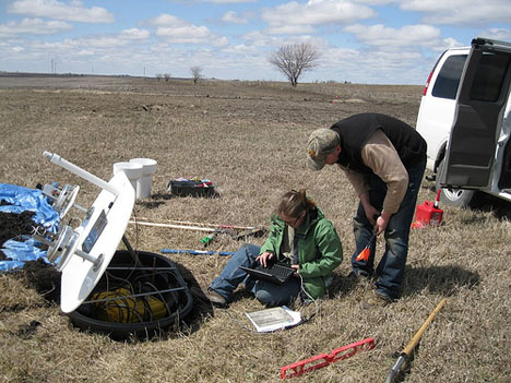 April 23, 2013. Setting up another rain gauge and soil moisture platform for IFloodS. Credit: Iowa Flood Center