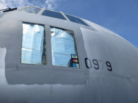 C-130 window with credit card stickers