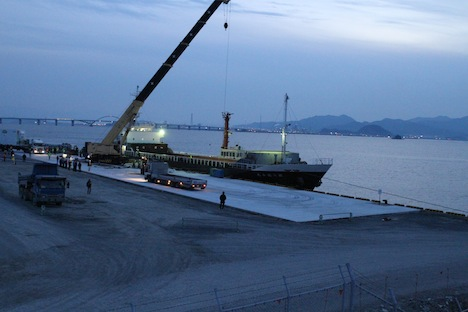 Recent improvements to the Kitakyushu airport in Japan facilitated the transportation of the GPM satellite. A freshly paved concrete staging area supported a massive crane as it lifted the satellite into the cargo hold of an ocean barge. Credit: NASA / Michael Starobin