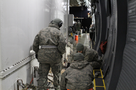 The crew securing the GPM shipping container to the deck. Credit: NASA / Michael Starobin