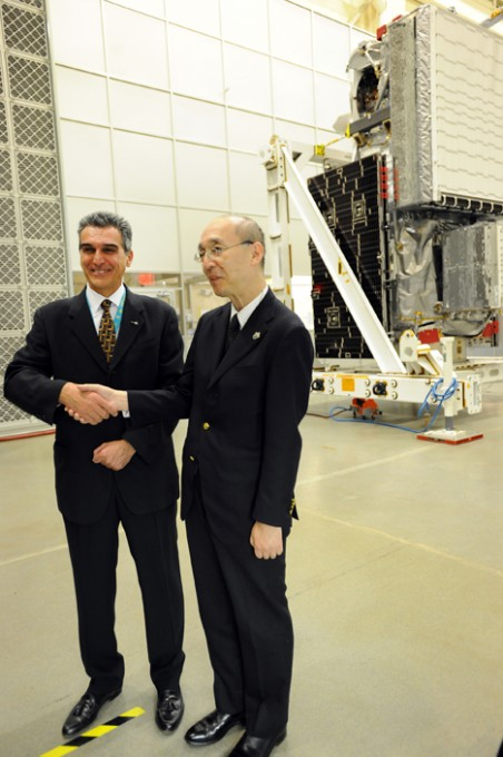 NASA's GPM Project Manager Art Azarbarzin (left) and JAXA's GPM Project Manager Masahiro Kojima in front of the GPM satellite at its last public appearance on Nov 15, 2013. Credit: NASA