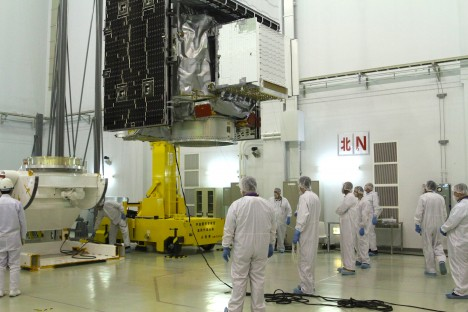 The GPM satellite is moved by crane across the clean room to the Aronson table which will support the satellite while the GPM team does its final preparations and testing before launch. Credit: NASA / Micheal Starobin