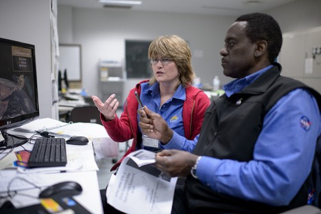 NASA GPM Safety Quality and Assurance, Shirley Dion, and, NASA GPM Quality and Assurance, Larry Morgan, monitor the all-day launch simulation for the Global Precipitation Measurement (GPM) Core Observatory at the Spacecraft Test and Assembly Building 2 (STA2), Saturday, Feb. 22, 2014, Tanegashima Space Center (TNSC), Tanegashima Island, Japan. Photo Credit: (NASA/Bill Ingalls)