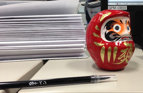 The colored in eye of the daruma doll in the Tanegashima launch support room. Credit: Cody Buell