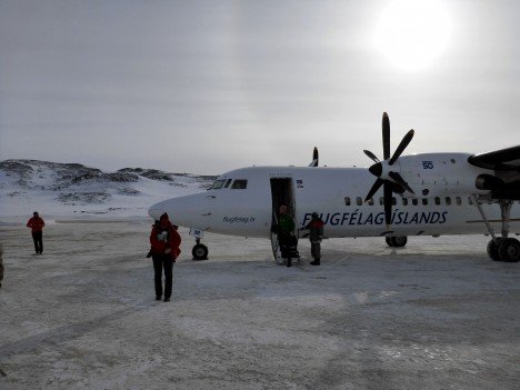Our plane, freshly landed at the Kulusuk airport, with a faint sun halo in the background. (Credit: Rick Foster)