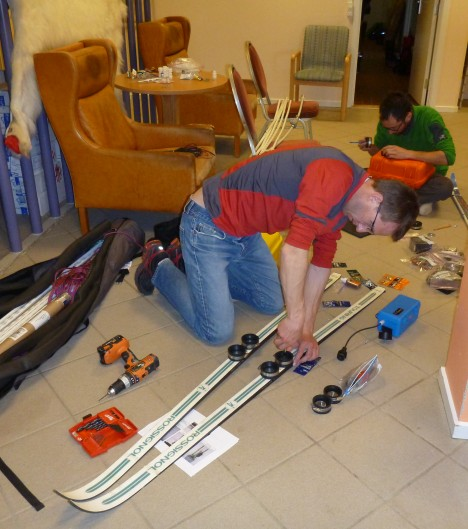 : Ludo, fixing special bindings on the skis to attach the radar box to them (Credit: Rick Foster.)