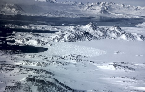View from the plane of the sea ice around Kulusuk  (the little black dots are houses.) (Credit: Ludovic Brucker)