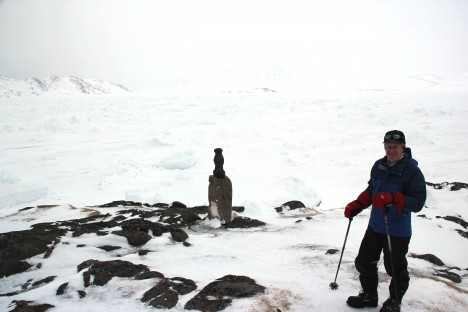 Rick in front of the broken and refrozen sea ice. Imagine how different it is from the open ocean in the summer, with boats cruising around.  (Credit: Clément Miège.)