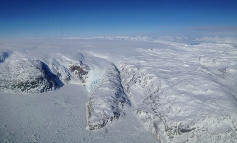 Flying over the sea-ice covered Sermilik fjord to reach the ice sheet.